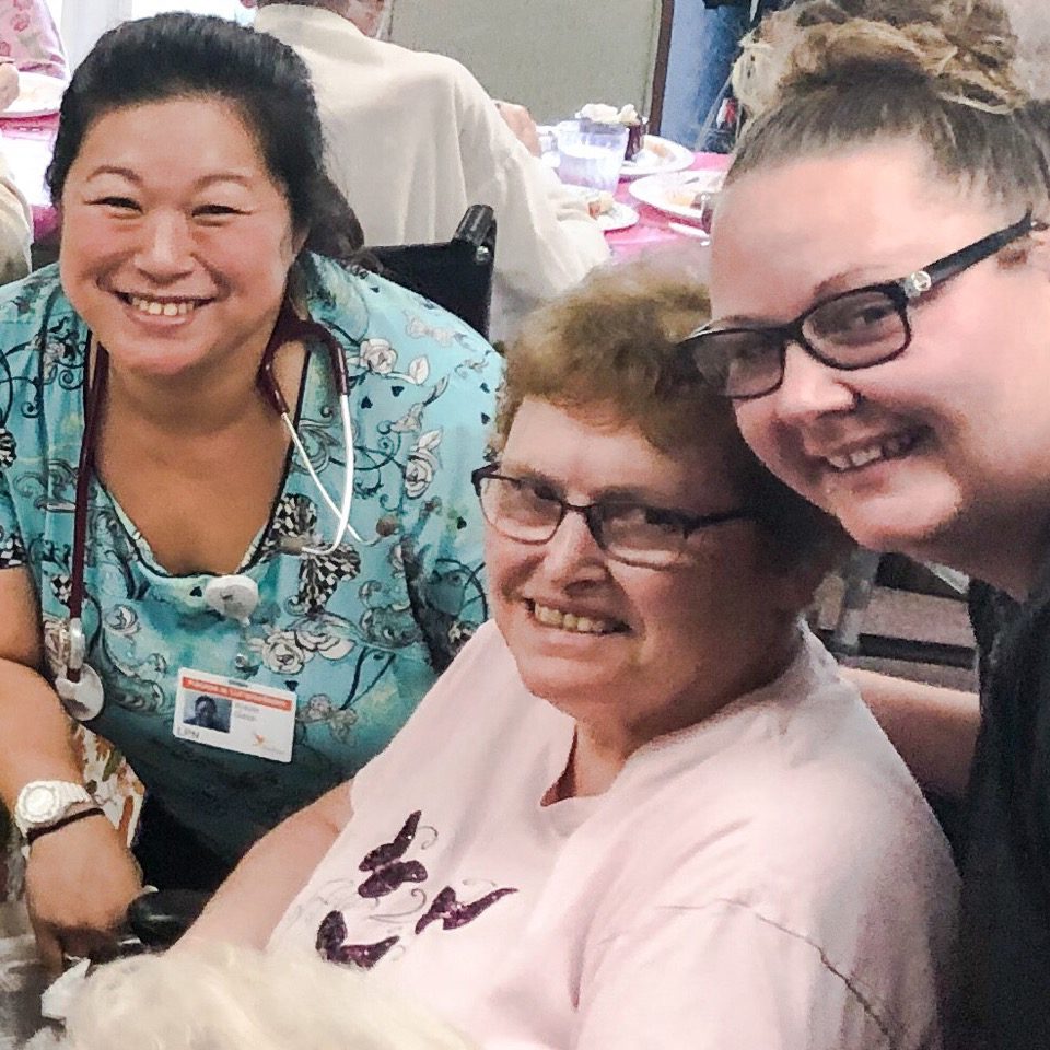 Image of staff members with old woman at Kadima at Campbelltown Nursing and Rehabilitation Facility