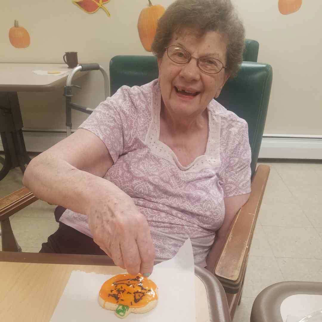 Image old woman decorating Halloween cookies at Kadima at Lakeside Nursing and Rehabilitation Facility