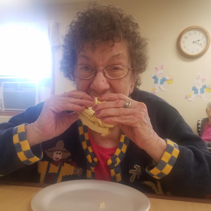 Image of resident woman eating at Kadima at Lakeside Nursing and Rehabilitation Facility