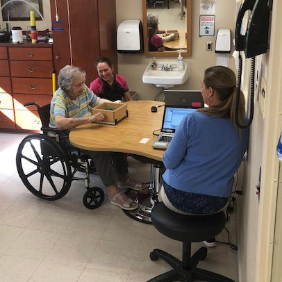 Image of woman in wheelchair and staff at Kadima at Lititz Nursing and Rehabilitation Facility