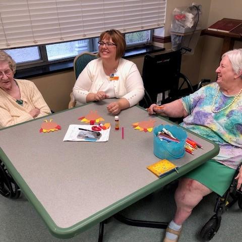 Image of elderly women doing arts and crafts at Kadima at Lititz Nursing and Rehabilitation Facility