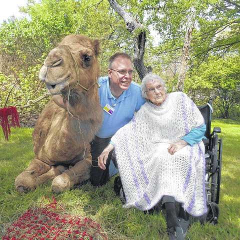 Image of Elderly woman and Camel outside Kadima at Luzerne Nursing and Rehabilitation Facility