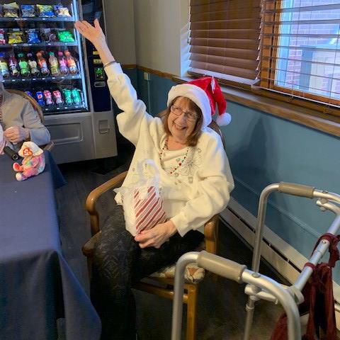 Image of elderly woman wearing a santa hat at Kadima Healthcare Group Nursing and Rehabilitation Facility