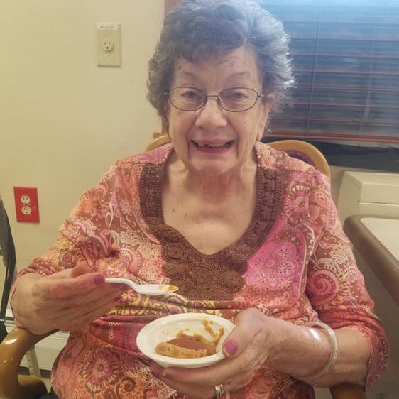 Image of Elderly woman eating at Kadima at Lakeside Nursing and Rehabilitation Facility