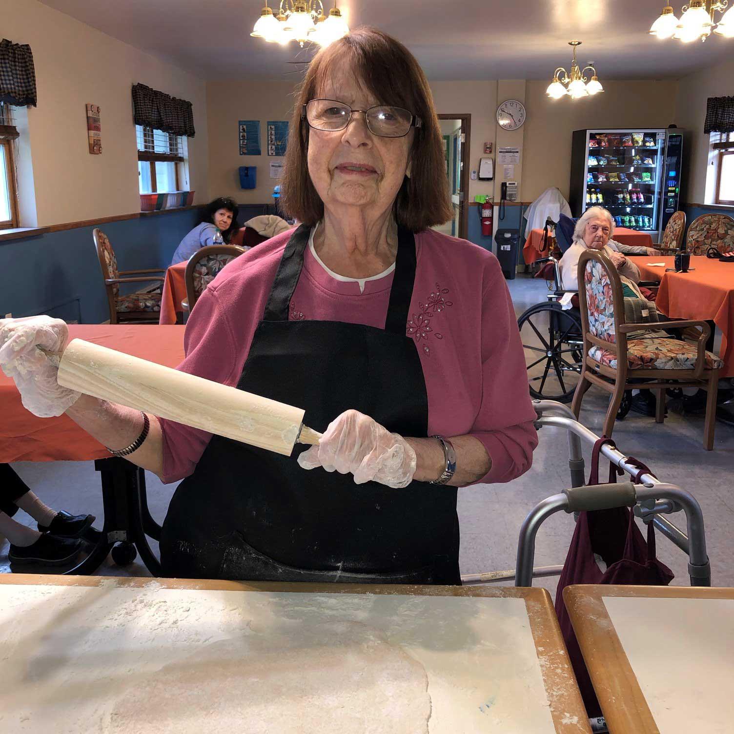 Image of senior woman baking at Kadima at Luzerne Nursing and Rehabilitation Facility