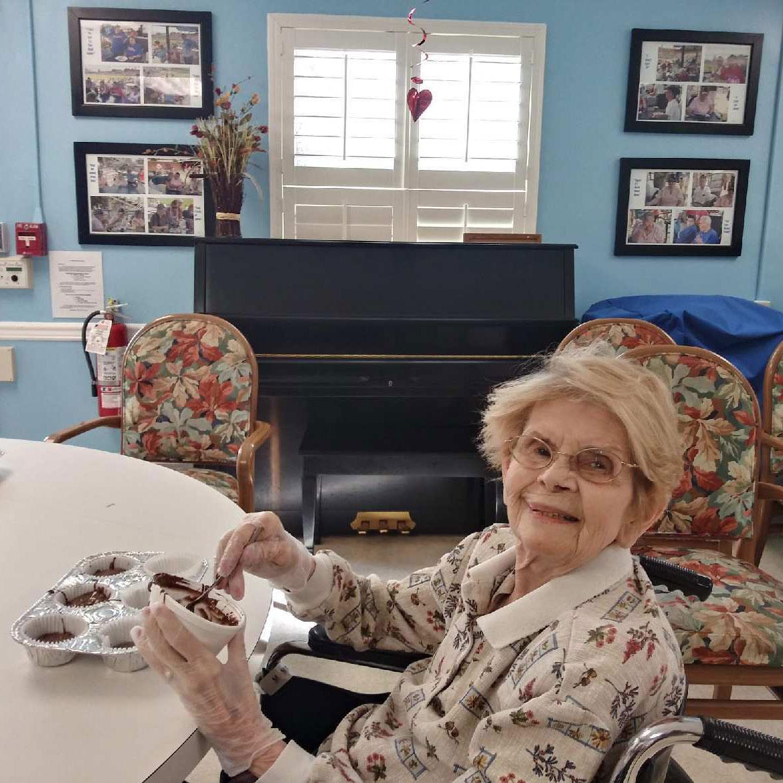 Image of old woman baking cupcakes at Kadima at Pottstown Nursing and Rehabilitation Facility